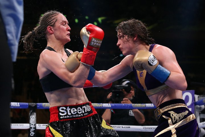 Katie Taylor giving a body shot punch to Delfine Persoon in Gold Cleto Reyes gloves.