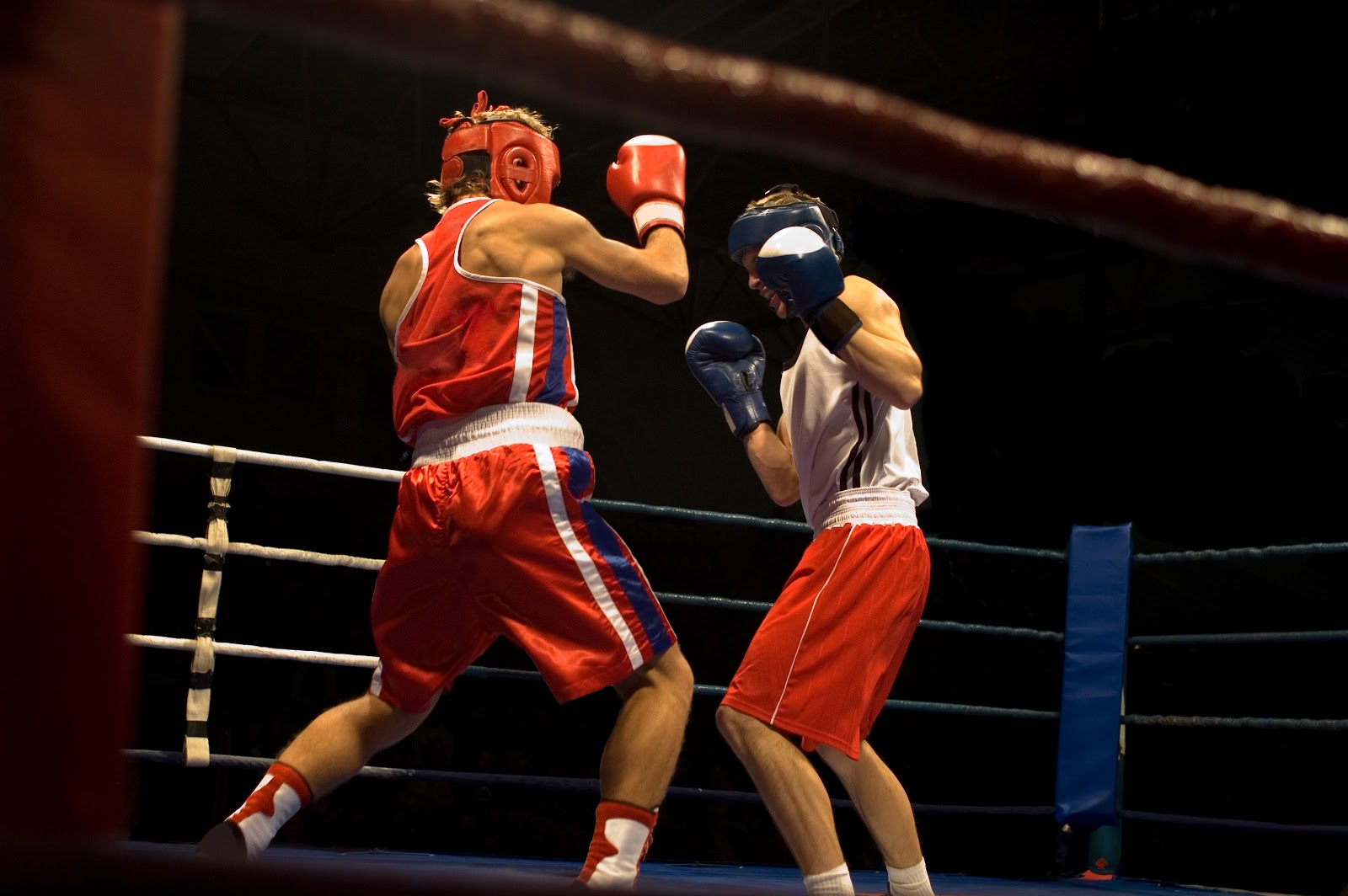 Action shot of amateur boxing fight in the ring.