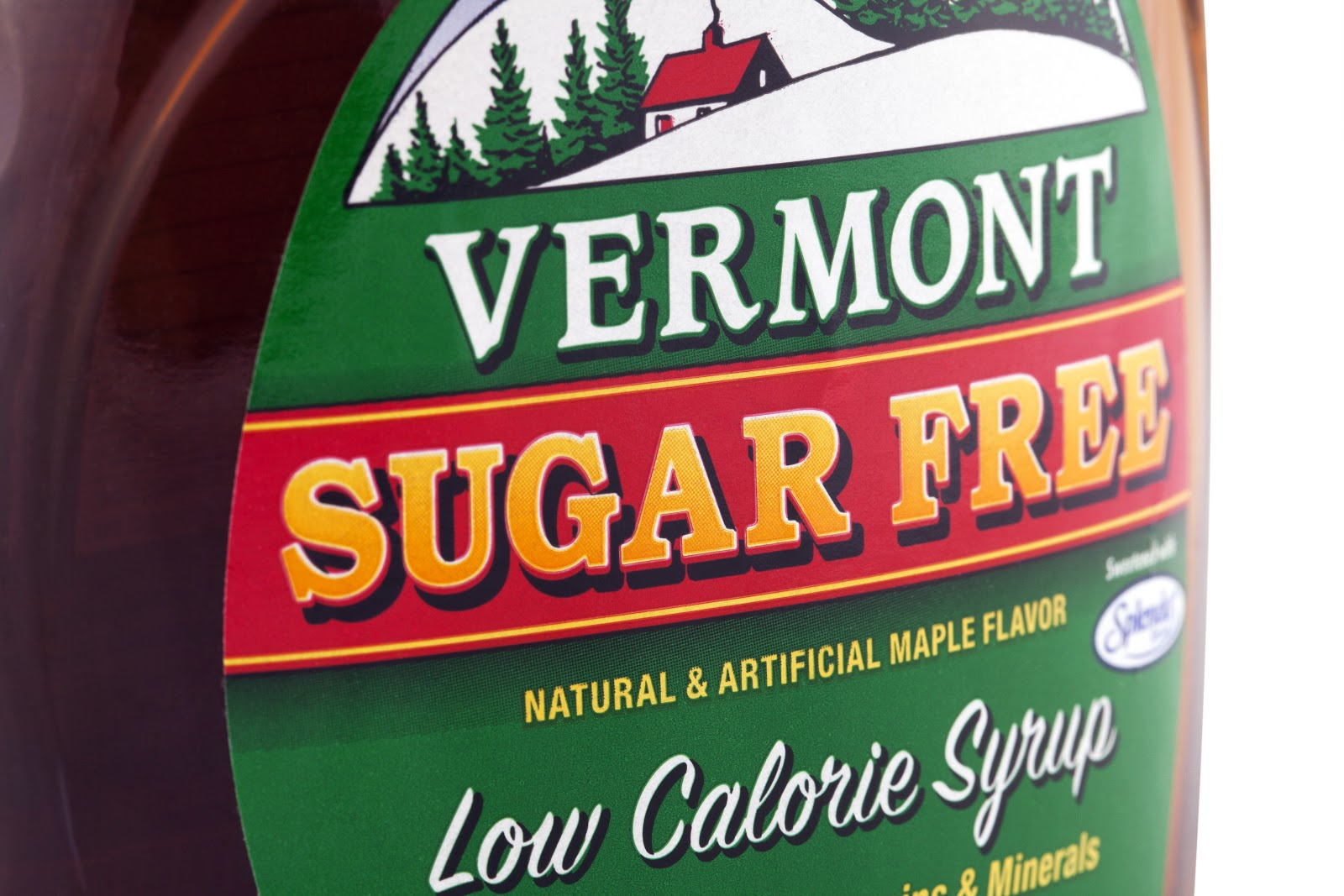 A maple syrup food label that is 'low calorie' and 'sugar fee' from Vermont.