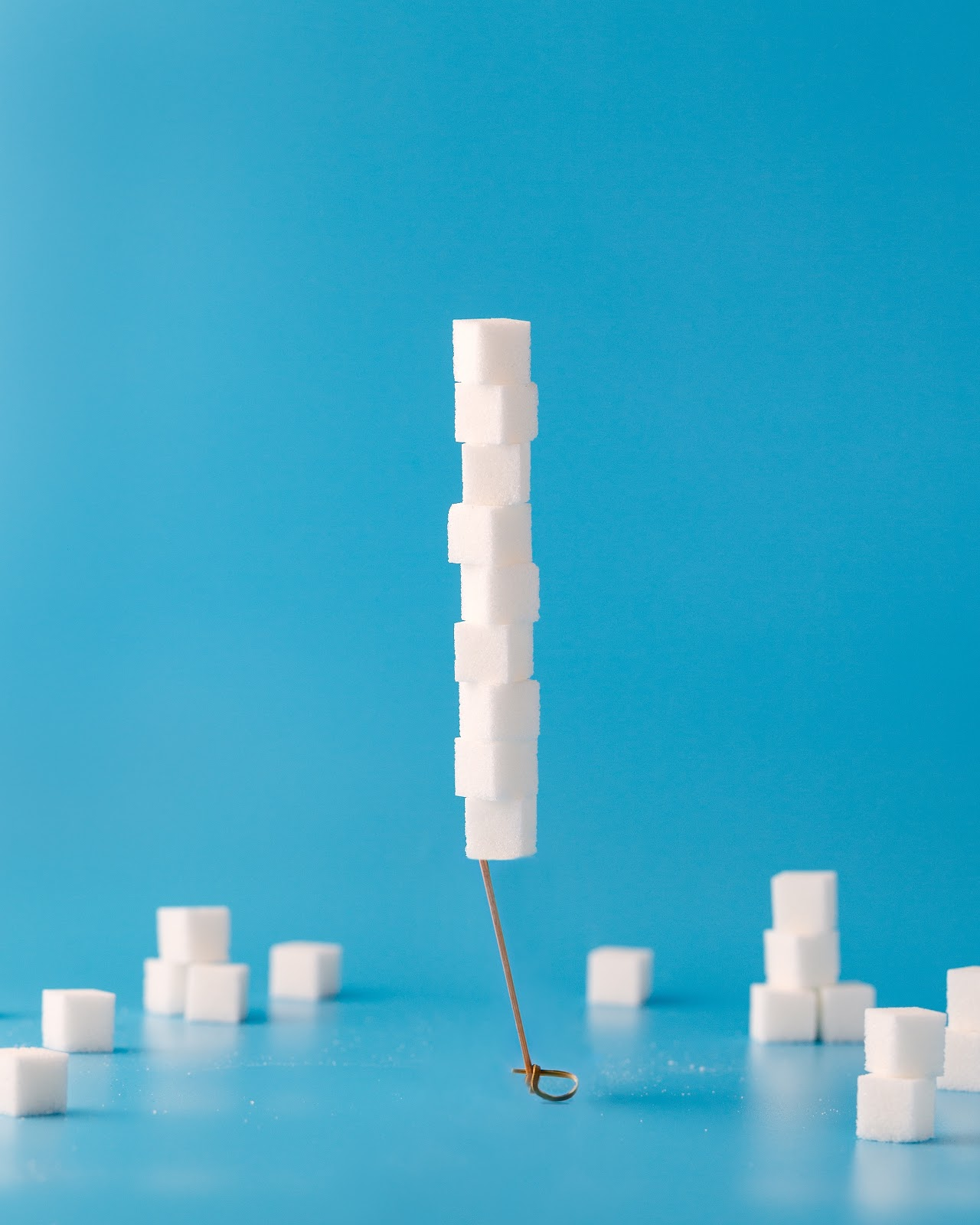Sugar cubes stacked on top of one another suspended in mid air.